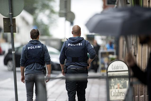 <p>Armed police officers secure the area after several people were stabbed on the Market Square in Turku, Finland, Aug. 18, 2017. (Roni Lehti/Lehtikuva via AP) </p>