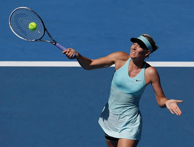Maria Sharapova of Russia hits a forehand return to Karin Knapp of Italy during their second round match at the Australian Open tennis championship in Melbourne, Australia, Thursday, Jan. 16, 2014.(AP Photo/Aaron Favila)