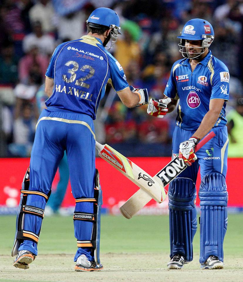 Mumbai Indian captain Rohit Sharma and Mumbai Indian player Glenn Maxwell during match 58 of the Pepsi Indian Premier League ( IPL) 2013  between The Pune Warriors India and the Mumbai Indians held at the Subrata Roy Sahara Stadium, Pune on the 11th May 2013. (BCCI)