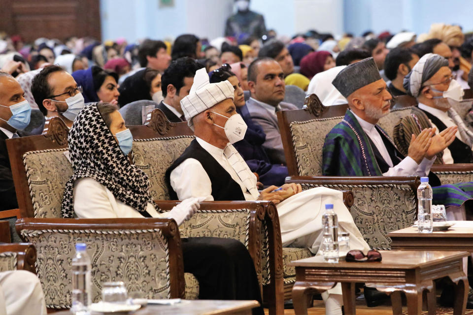 Afghan President Ashraf Ghani, center left, wears a protective face mask to help curb the spread of the coronavirus, on the last day of an Afghan Loya Jirga or traditional council, in Kabul, Afghanistan, Sunday, Aug. 9, 2020. The council concluded Sunday with hundreds of delegates agreeing to free 400 Taliban members, paving the way for an early start to negotiations between Afghanistan's warring sides. (AP Photo)