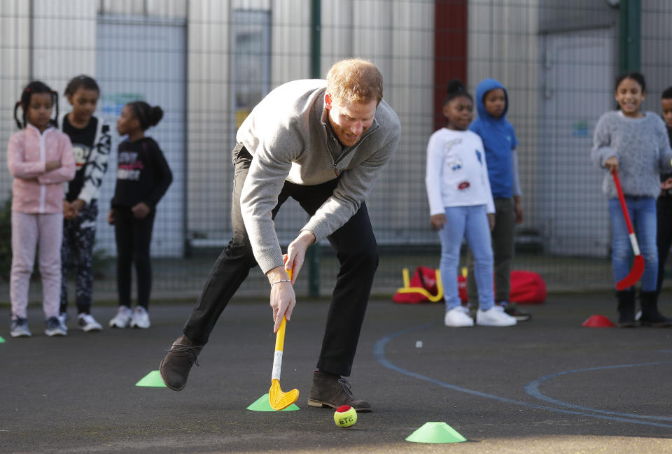 LONDON, ENGLAND - FEBRUARY 15: Prince Harry shows off his hockey skills as he visits a Fit and Fed February school holiday activity programme at the Roundwood Youth Centre on February 15, 2017 in London, England. The Fit and Fed Campaign aims to provide children and young people with free access to activity sessions and a nutritious lunch during school holidays, with community sport and wellbeing charity 'Sport at the Heart' which is part of the Fit and Fed campaign. (Photo by Frank Augstein - WPA Pool/Getty Images)