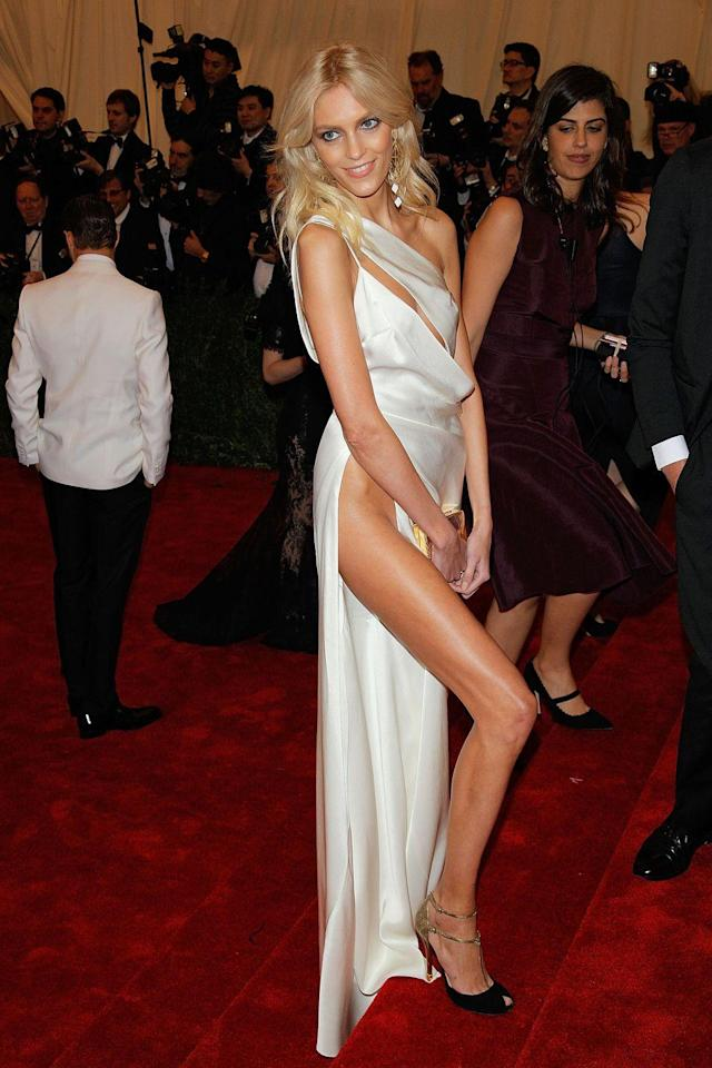 """<p>Polish Model Anja Rubik showed up to the 2012 Met Gala """"Schiaparelli and Prada: Impossible Conversations"""" in a white gown designed by Anthony Vaccarello. Rubik received the unspoken award for highest leg slit on any Met Gala gown. </p>"""