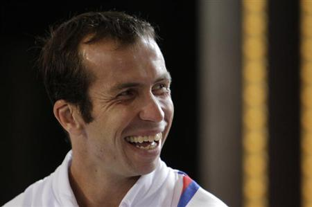 Czech Republic's Radek Stepanek smiles during the draw for the Davis Cup semifinals in Prague September 12, 2013.