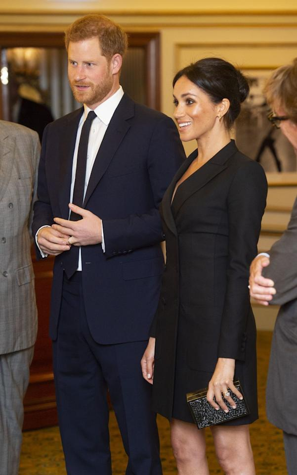 """<p>The couple showed up with matching smiles <a rel=""""nofollow"""" href=""""https://www.townandcountrymag.com/style/fashion-trends/a22861883/meghan-markle-black-mini-dress-judith-charles-hamilton-sentebale-gala/"""">and coordinating black ensembles</a> to the gala performance of the hit musical in London. </p>"""