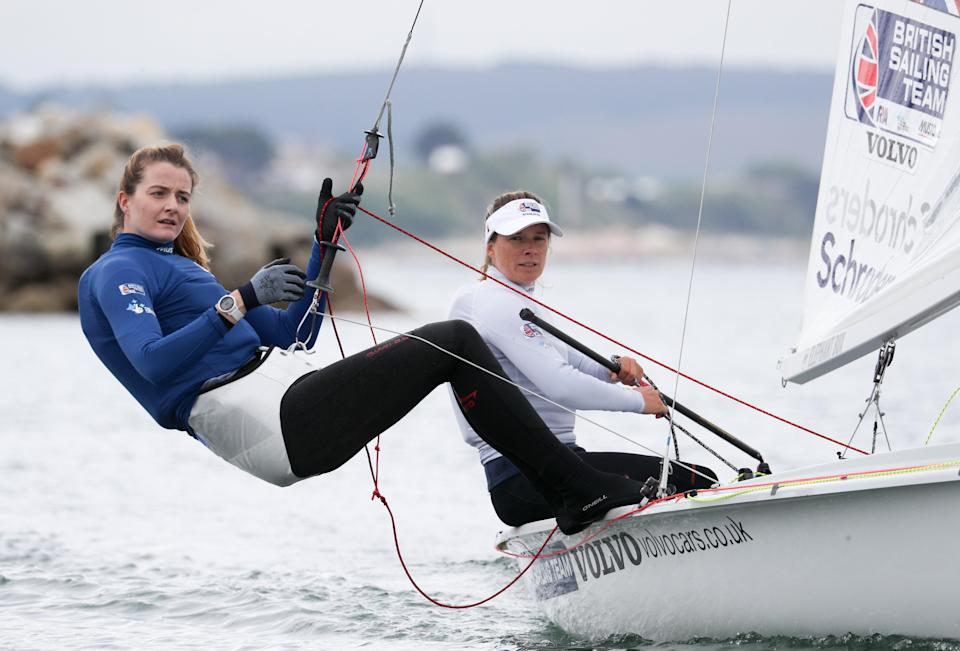 Great Britain's Eilidh McIntyre and Hannah Mills, right, have secured a medal in the 470 class (PA) (PA Archive)