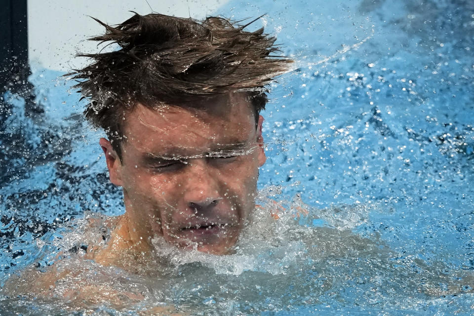 Robert Finke, of United States, celebrates after winning the gold medal in the men's 1500-meter freestyle final at the 2020 Summer Olympics, Sunday, Aug. 1, 2021, in Tokyo, Japan. (AP Photo/Jae C. Hong)
