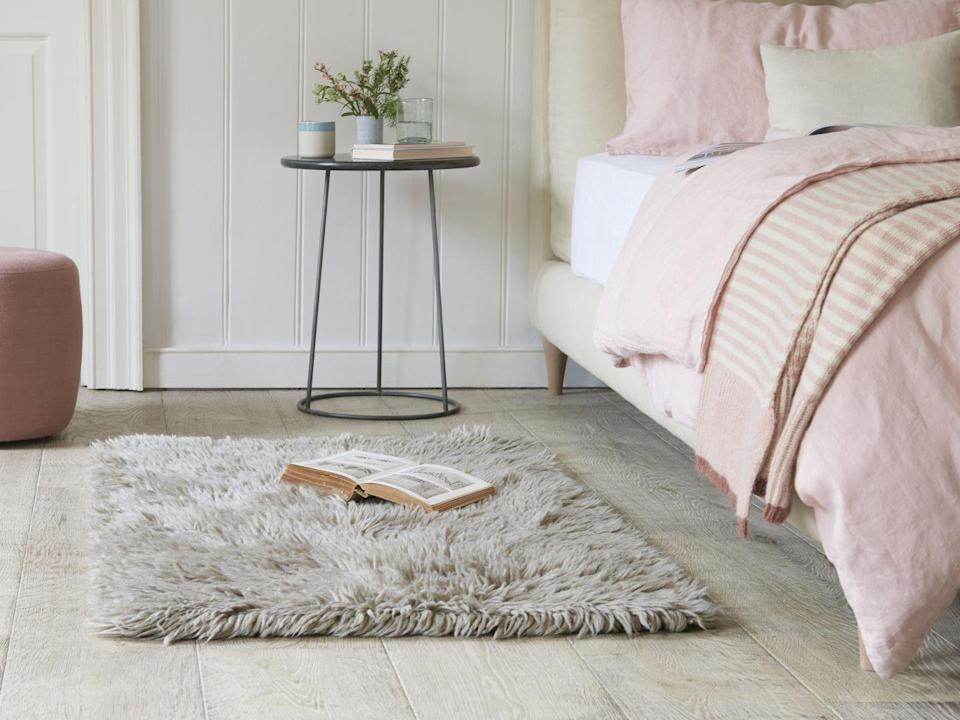 """<p>Rather than having everything too matchy matchy, introduce grey as a pale neutral in a bedroom with pink bedlinen. A rug like this one will add texture and warmth just where you need it, and makes getting out of bed a bit more bearable!</p><p>Top Tip: If you are laying a rug on bare boards, make sure you put an <a href=""""https://www.amazon.co.uk/Rugs-Stuff-Gripper-Underlay-Floors/dp/B00AK9TKY8?tag=hearstuk-yahoo-21&ascsubtag=%5Bartid%7C2060.g.35432015%5Bsrc%7Cyahoo-uk"""" rel=""""nofollow noopener"""" target=""""_blank"""" data-ylk=""""slk:anti-slip rug gripper"""" class=""""link rapid-noclick-resp"""">anti-slip rug gripper</a> underneath it to stop it moving.</p><p>Pictured: <a href=""""https://loaf.com/products/wilder-floor-rug-in-grey"""" rel=""""nofollow noopener"""" target=""""_blank"""" data-ylk=""""slk:Wilder bedside rug in grey, Loaf"""" class=""""link rapid-noclick-resp"""">Wilder bedside rug in grey, Loaf</a><br></p>"""