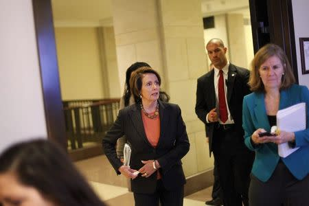 U.S. House Minority Leader Nancy Pelosi (D-CA) (C) arrives for a news conference about pending legislation regarding Department of Homeland Security funding, at the U.S. Capitol in Washington, February 27, 2015. REUTERS/Jonathan Ernst