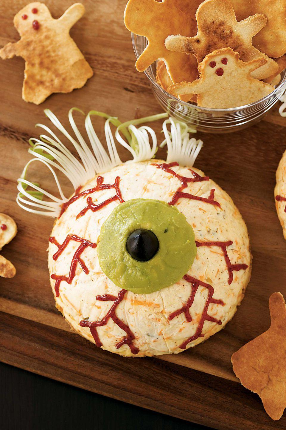 "<p>Your guests will get an eye-full of delicious when they dig in to this cheesy peeper. Scallion eyelashes and a guacamole iris upgrade the party favorite. </p><p><strong><a href=""https://www.womansday.com/food-recipes/food-drinks/recipes/a10878/eyeball-cheesecakes-recipe-122182/"" rel=""nofollow noopener"" target=""_blank"" data-ylk=""slk:Get the recipe."" class=""link rapid-noclick-resp"">Get the recipe.</a></strong></p>"