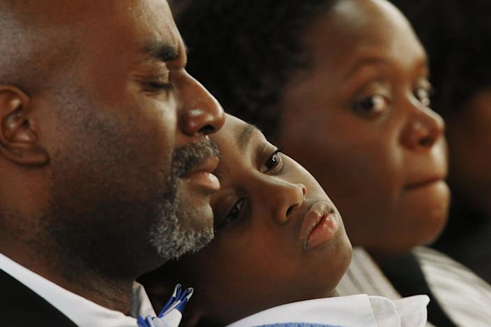 Churchgoer's attend a memorial service at the 16th Street Baptist Church in Birmingham, Ala., Sunday, Sept. 15, 2013. The church held a ceremony honoring the memory of the four young girls who were killed by a bomb placed outside the church 50 years ago by members of the Ku Klux Klan. (AP Photo/Hal Yeager)