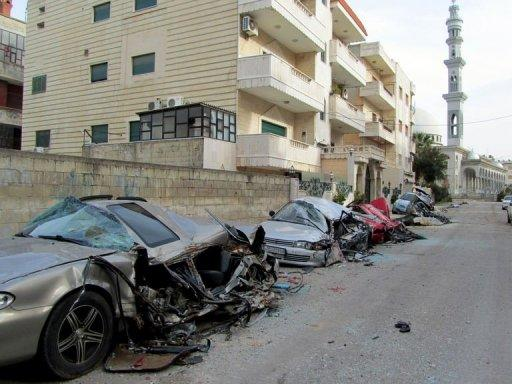 A handout picture taken in February 2012, and released by the official Committee of the Syrian Revolution, allegedly shows damaged cars demolished by Syrian forces driving over them with army tanks in the flashpoint city of Homs. UN-Arab League envoy Kofi Annan left Damascus on Sunday without managing to secure an accord to end bloodletting in Syria