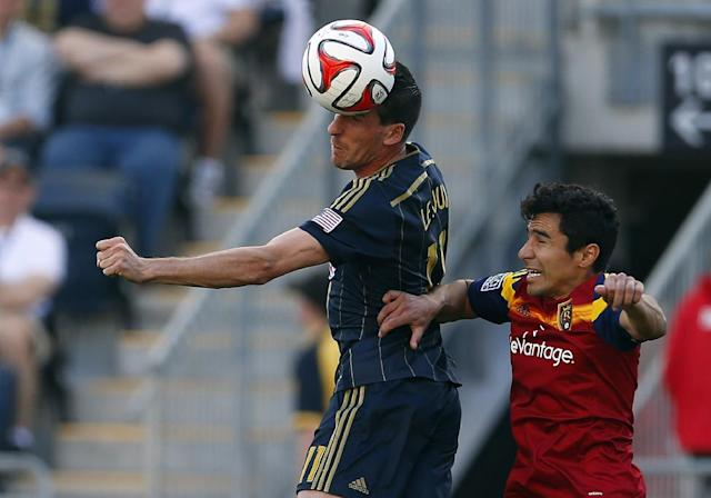 Philadelphia Unions' Sebastien Le Toux, left, of France, heads the ball from Real Salt Lakes' Tony Beltran (2) in the first half during an MLS soccer match at PPL Park in Chester, PA., Saturday, April 12, 2014. (AP Photo/Rich Schultz)