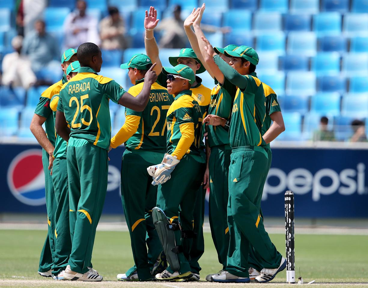 DUBAI, UNITED ARAB EMIRATES - MARCH 01:  Players of South Africa celebrate after dismissing Sami Aslam of Pakistan during the ICC U19 Cricket World Cup 2014 Super League Final match between South Africa and Pakistan at the Dubai Sports City Cricket Stadium on March 1, 2014 in Dubai, United Arab Emirates.  (Photo by Francois Nel - IDI/IDI via Getty Images)