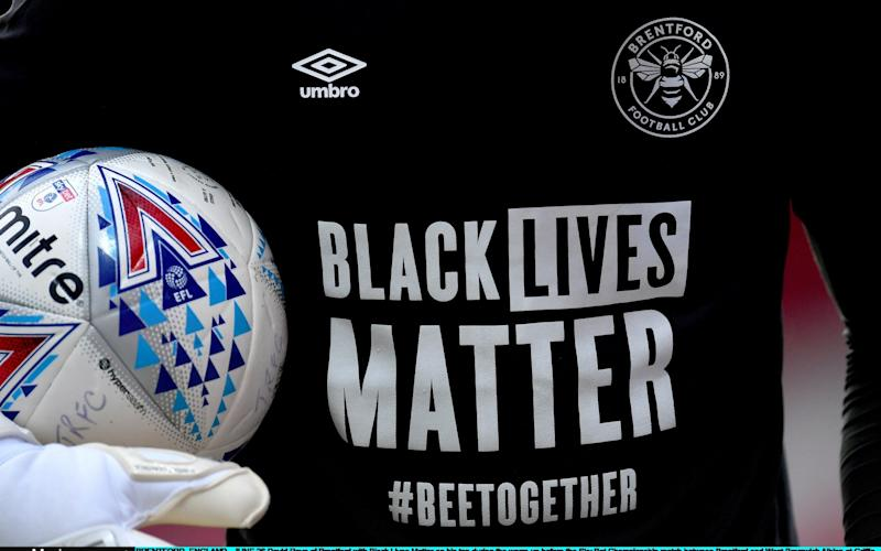 David Raya of Brentford with Black Lives Matter on his top during the warm-up before the Sky Bet Championship match between Brentford and West Bromwich Albion at Griffin Park on June 26, 2020 in Brentford, England - Getty Images Europe