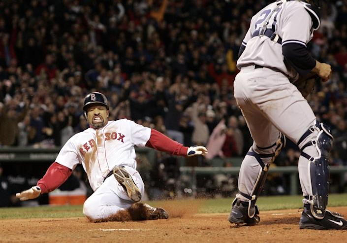 Boston Red Sox's Dave Roberts, left, slides home to score the tying run against the New York Yankees.