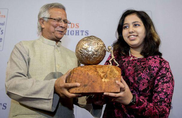 PHOTO: In this Dec. 2, 2016, file photo, Indian teen environmental activist Kehkashan Basu, 16, receives the International Children's Peace Prize 2016, from Nobel Peace Prize Winner Muhammad Yunus, at the Ridderzaal in The Hague, The Netherlands. (Jerry Lampen/AFP via Getty Images, FILE)
