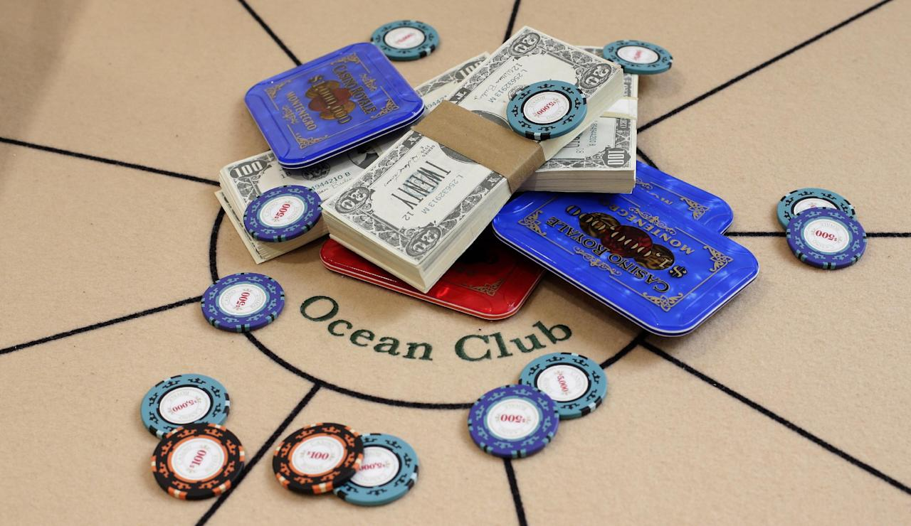 A poker table and gambling props from the One and Only Ocean Club and used in the 2006 version of the movie 'Casino Royale' are seen at the press preview of the James Bond movie memorabilia charity auction at Christie's auction house in London, Friday, Sept. 28, 2012. The table and props are expected to sell fro some 3-5,000 British pounds ($ 4,600-7,500, euro 3,400-5,600) with the proceeds going to UNICEF. (AP Photo/Alastair Grant)