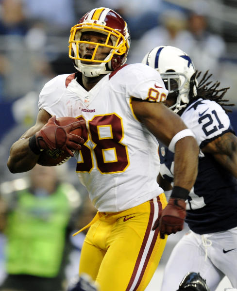 Washington Redskins wide receiver Pierre Garcon (88) outruns Dallas Cowboys' Mike Jenkins (21) as he heads for the end zone for a touchdown in the first half of an NFL football game, Thursday, Nov. 22, 2012, in Arlington, Texas. (AP Photo/Matt Strasen)