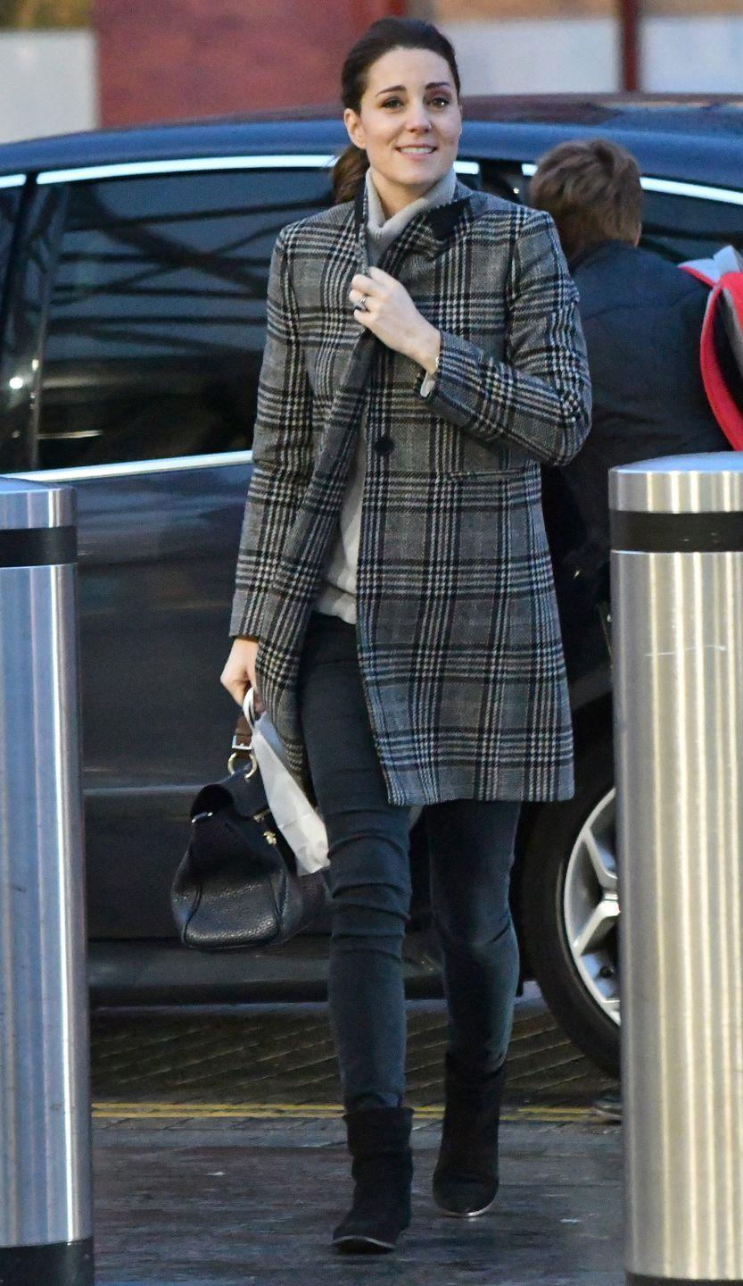 <p>In a plaid Zara coat, gray turtleneck sweater, black skinny jeans, black booties, and a leather handbag.</p>