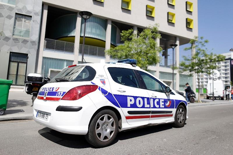 A police vehicle is parked outside the student residence where an It student -- suspected of planning an attack on churches -- lived in Paris, on April 22, 2015 (AFP Photo/Kenzo Tribouillard)