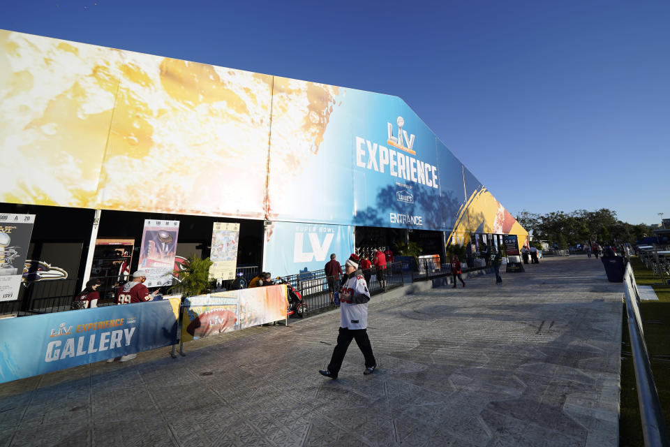 Fans walk through the NFL Experience for Super Bowl LV Friday, Jan. 29, 2021, in Tampa, Fla. (AP Photo/David J. Phillip)