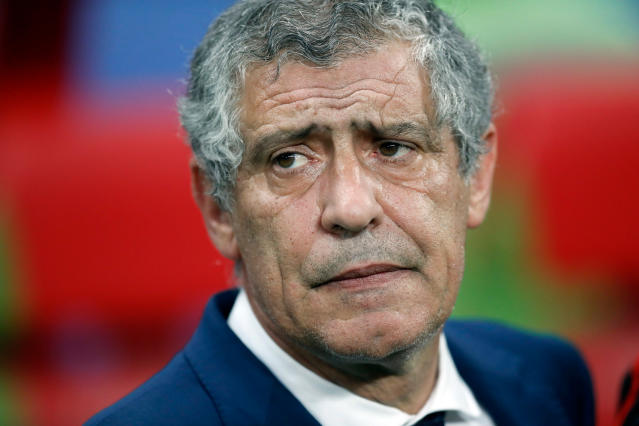 FILE - In this Wednesday, June 28, 2017 filer Portugal coach Fernando Santos waits for the kick-off of the Confederations Cup, semifinal soccer match between Portugal and Chile, at the Kazan Arena, Russia. (AP Photo/Pavel Golovkin, File)