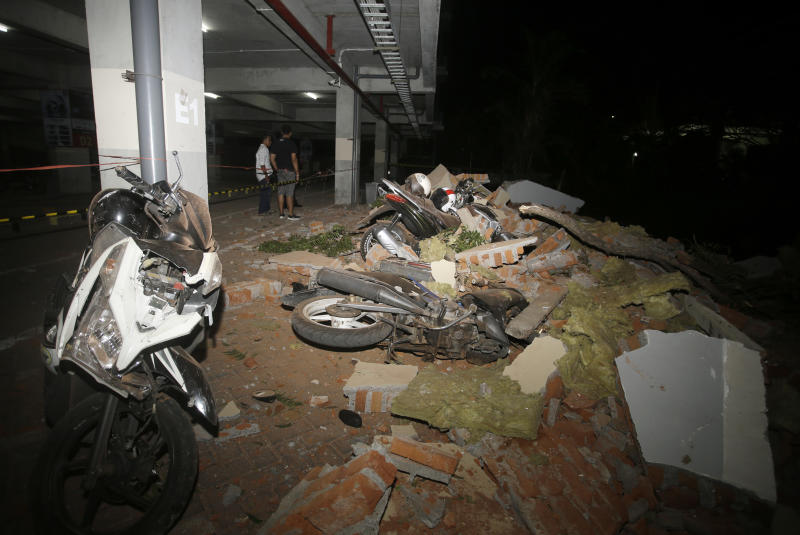 Motorcycles crushed after magnitude 7.0 earthquake kills dozens in Indonesia.