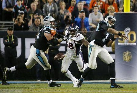 Denver Broncos' Von Miller (58) strips the ball away from Carolina Panthers' quarterback Cam Newton (1) during the fourth quarter of the NFL's Super Bowl 50 football game in Santa Clara, California February 7, 2016. REUTERS/Stephen Lam