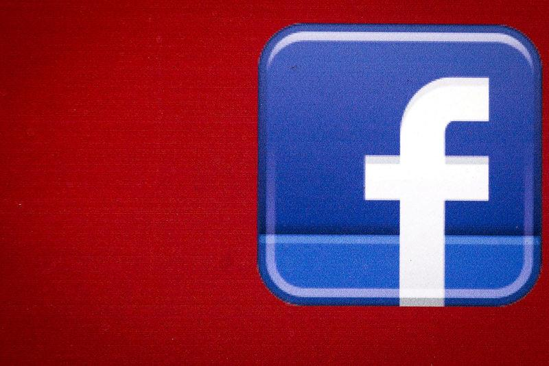 FILE PHOTO - A Facebook logo is displayed on the side of a tour bus in New York's financial district