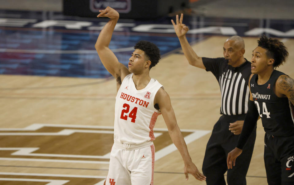 Houston guard Quentin Grimes (24) attempts a 3-point shot as Cincinnati guard Jeremiah Davenport (24) looks on during the first half of an NCAA college basketball game in the final round of the American Athletic Conference men's tournament Sunday, March 14, 2021, in Fort Worth, Texas. (AP Photo/Ron Jenkins)