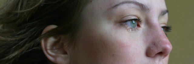 photo of woman crying red eyes