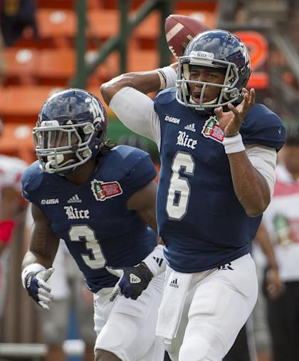 Rice quarterback Driphus Jackson (6) drops back to pass in the first quarter of the Hawaii Bowl against Fresno State, Wednesday, Dec. 24, 2014, in Honolulu. (AP Photo/Eugene Tanner)
