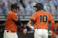 San Francisco Giants Evan Longoria (10) celebrates with Wilmer Flores after hitting a home run off Oakland Athletics' Jesus Luzardo in the first inning of a baseball game Friday, Aug. 14, 2020, in San Francisco. (AP Photo/Ben Margot)