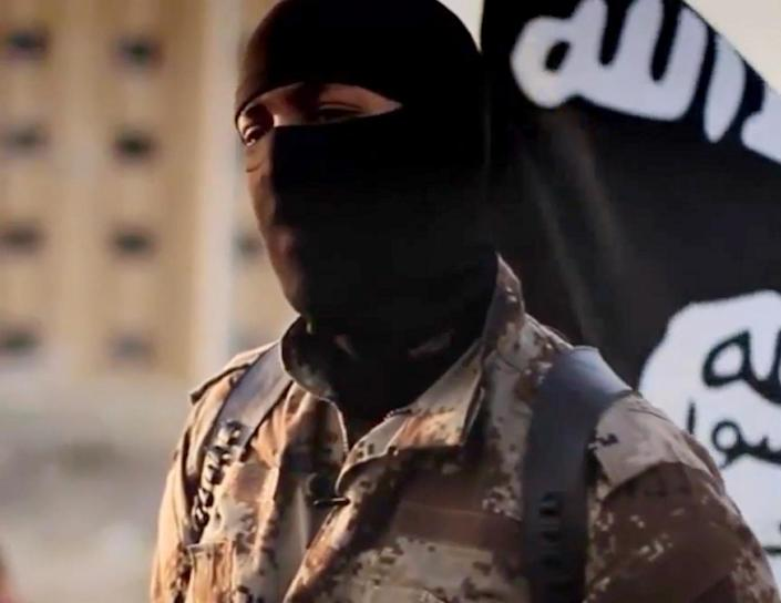 A screen shot released October 7, 2014 shows an English-speaking individual, who was seen in an Islamic State group propaganda video (AFP Photo/Ho)