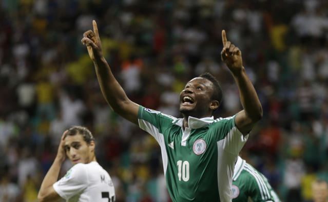 FILE - In this June 20, 2013, file photo, Nigeria's John Obi Mikel celebrates scoring his side's first goal during the soccer Confederations Cup group B match between Nigeria and Uruguay at Fonte Nova stadium in Salvador, Brazil. After impressing on their way to the second round in each of their first two FIFA World Cup appearances, 1994 and 1998, Nigeria have struggled since: going out at the group stage three times while taking just two points from their last eight matches in the finals. (AP Photo/Natacha Pisarenko, File)