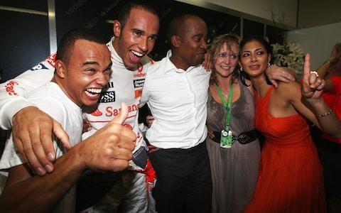 Team Hamilton celebrate his first world title in 2008: brother Nic, Lewis, father Anthony, stepmother Linda and then-girlfriend Nicole Scherzinger - Credit: Getty