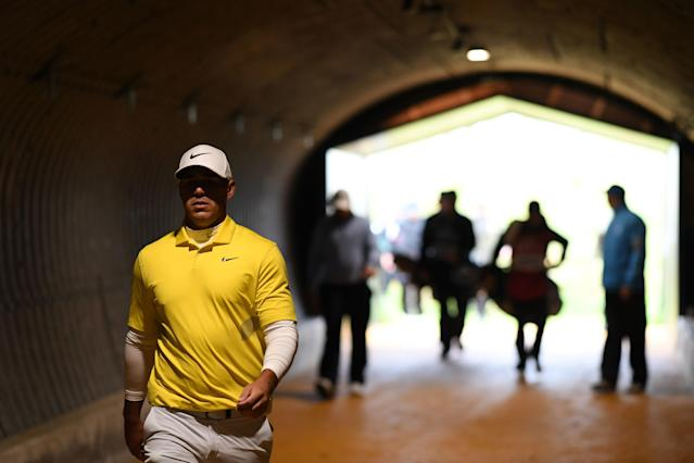 """<div class=""""caption""""> Koepka walks briskly through a tunnel on the Portrush course on Sunday as his playing parter, Holmes, is off in the distance. </div> <cite class=""""credit"""">Richard Heathcote/R&A</cite>"""