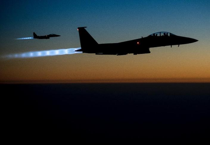 A US Air Force Central Command photograph shows two F-15E Strike Eagles returning from carrying out air strikes against the Islamic State group in Syria on September 23, 2014 (AFP Photo/Senior Airman Matthew Bruch)