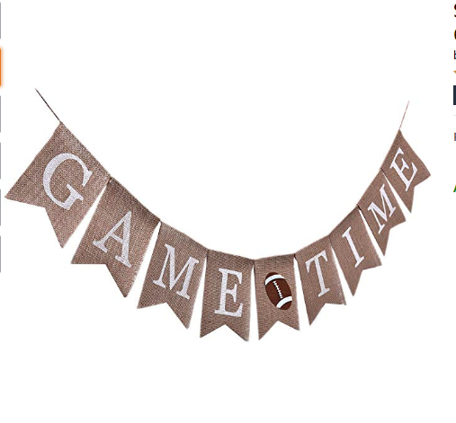 "<p>Hang this burlap banner above the television to get everyone in the game day spirit. Plus, you can reuse this banner year after year, no matter who is playing.<br></p><p><a class=""link rapid-noclick-resp"" href=""https://www.amazon.com/Sports-Theme-Banner-Decoration-Decorations/dp/B07Z8926Z2/?tag=syn-yahoo-20&ascsubtag=%5Bartid%7C10055.g.4949%5Bsrc%7Cyahoo-us"" rel=""nofollow noopener"" target=""_blank"" data-ylk=""slk:SHOP BANNERS"">SHOP BANNERS</a></p>"