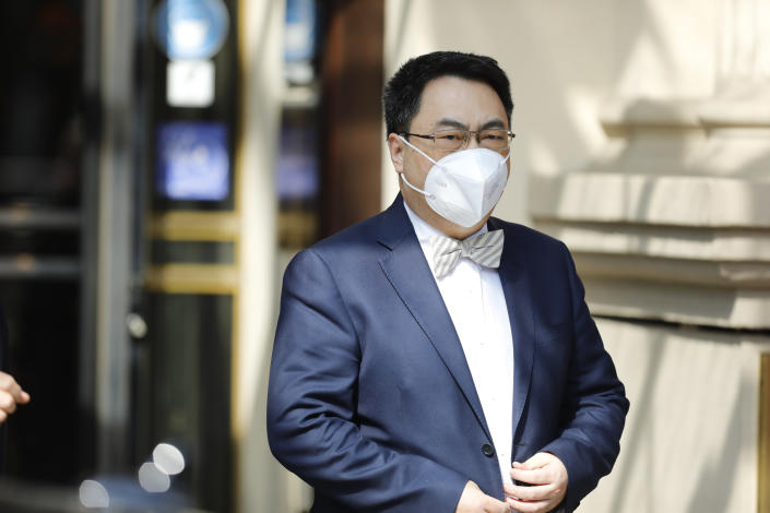 The ambassador of the Permanent Mission of the People's Republic of China to the United Nations, Wang Qun, leaves the 'Grand Hotel Vienna' where closed-door nuclear talks with Iran take place in Vienna, Austria, Tuesday, April 20, 2021. (AP Photo/Lisa Leutner)