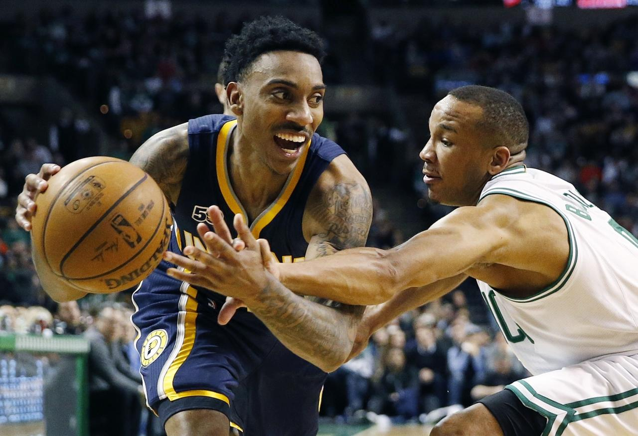 Indiana Pacers' Jeff Teague, left, drives past Boston Celtics' Avery Bradley during the fourth quarter of an NBA basketball game in Boston, Wednesday, March 22, 2017. The Celtics won 109-100. (AP Photo/Michael Dwyer)