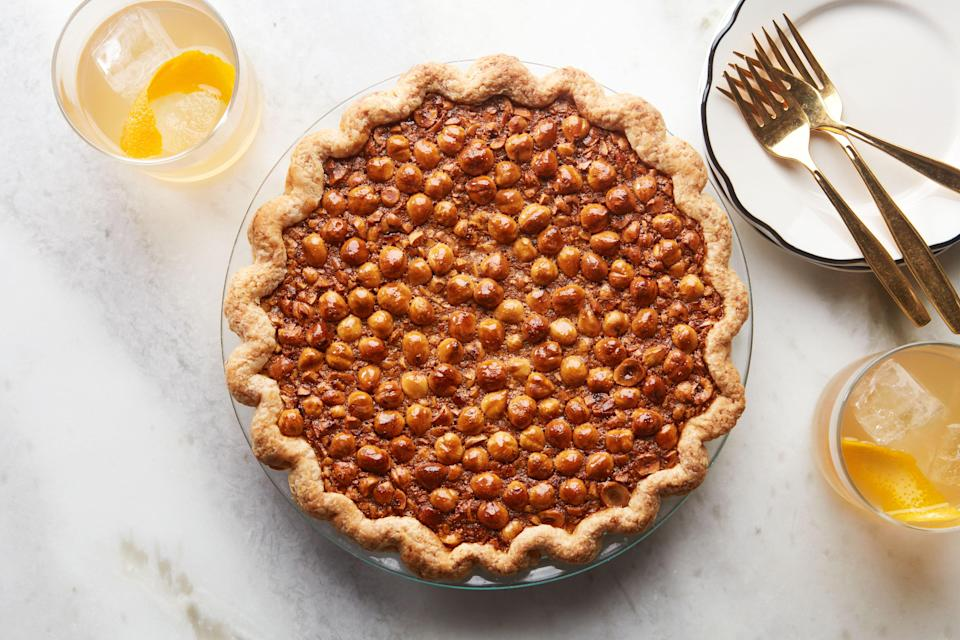 """We'll start you off with a banger: This is one of our favorite pie recipes because it's so well balanced. There's a secret layer of bittersweet chocolate underneath the gooey, espresso-infused filling. The topping? Perfectly crunchy sugar-coated hazelnuts. If you normally make pecan pie, try this recipe. <a href=""""https://www.epicurious.com/recipes/food/views/black-bottom-hazelnut-pie?mbid=synd_yahoo_rss"""" rel=""""nofollow noopener"""" target=""""_blank"""" data-ylk=""""slk:See recipe."""" class=""""link rapid-noclick-resp"""">See recipe.</a>"""