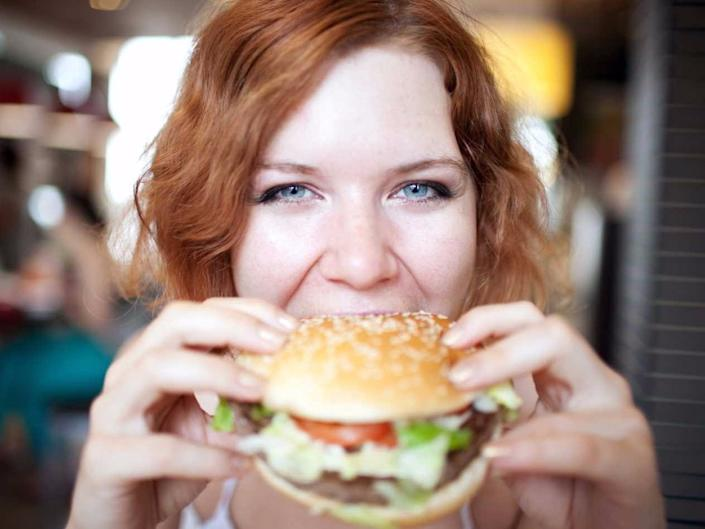 girl eating a burger hungry appetite 12