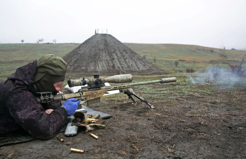 A sniper of the Ukrainian armed forces fires his rifle during training in Donetsk region