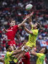 Canada's Jake Thiel, left, jumps for the ball against Australia's Nick Malouf (10) during the Challenge Trophy final at the World Rugby Sevens Series in Vancouver, British Columbia, Sunday, March 10, 2019. (Ben Nelms/The Canadian Press via AP)