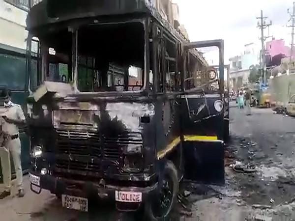 Visual of vehicles burnt by angry mob as the violence broke out over an alleged inciting social media post, at DJ Halli police station, in Bengaluru. (Photo/ANI)