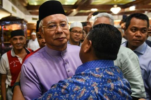 Malaysia ex-leaderNajib Razak was visibly under strain when he emerged for Friday prayers after the raid on his home