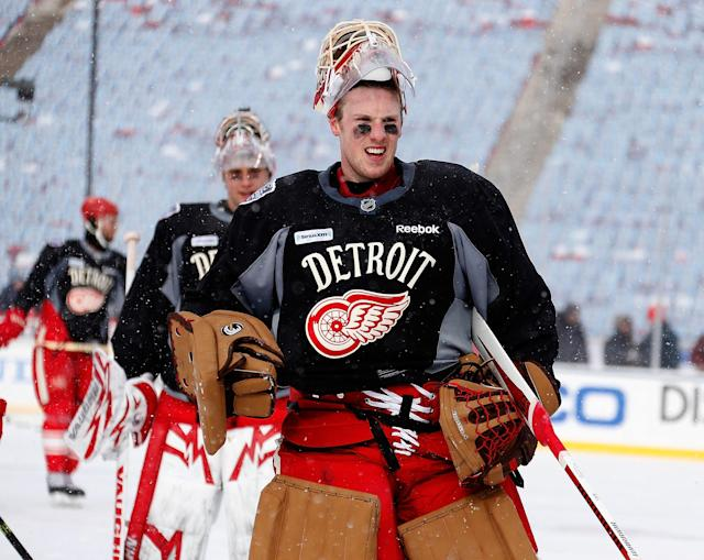 ANN ARBOR, MI - DECEMBER 31: (EDITORIAL USE ONLY) Jimmy Howard #35 of the Detroit Red Wings looks on at practice during 2014 Bridgestone NHL Winter Classic at Michigan Stadium on December 31, 2013 in Ann Arbor, Michigan. (Photo by Gregory Shamus/Getty Images)