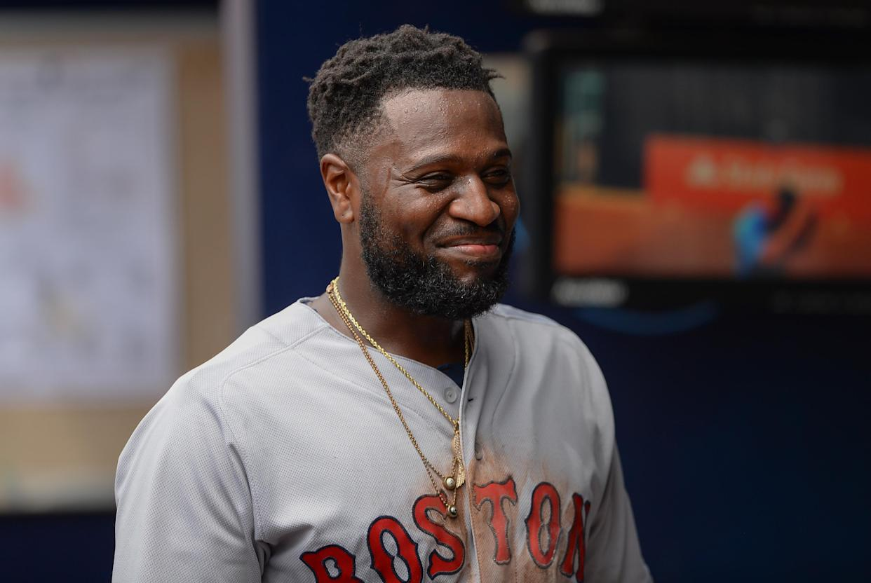 Brandon Phillips smiles during the Red Sox's 9-8 comeback win over the Braves. (Getty Images)