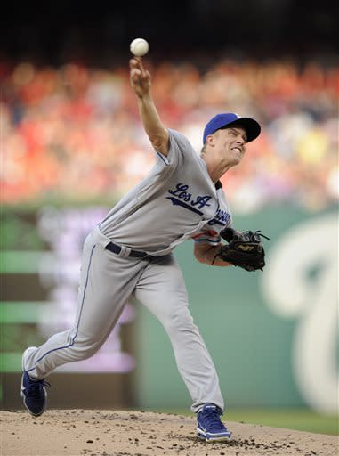 Los Angeles Dodgers starter Zack Greinke delivers a pitch against the Washington Nationals during the first inning of a baseball game, Saturday, July 20, 2013, in Washington. (AP Photo/Nick Wass)